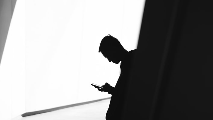 Man alone on mobile device